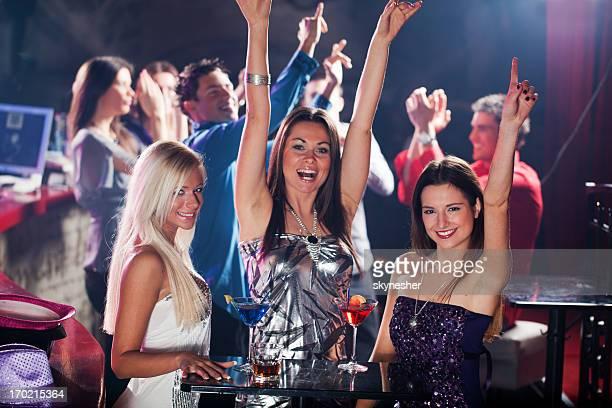 Three women dancing at the disco bar