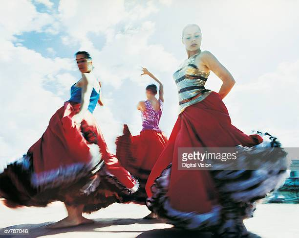 three women dancing the flamenco - flamenco dancing stock photos and pictures