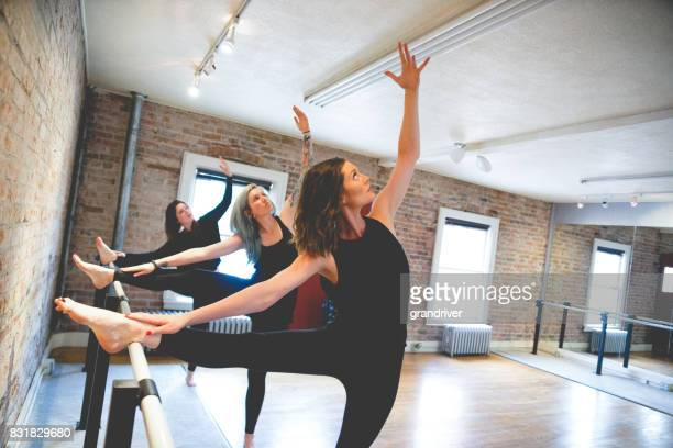 Three Women Doing Body Stretch on Barre