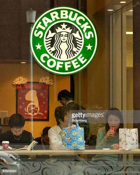Three women drink coffee in a Starbucks coffee shop in Tokyo on Wednesday December 22 2004 Japan's demand for services declined in October for the...