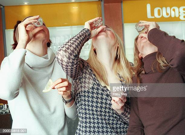 Three women drinking tequila shots