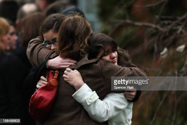 Three women embrace as they arrive for the funeral services of six year-old Noah Pozner, who was killed in the shooting massacre in Newtown, CT, at...