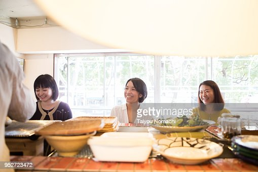 Three women enjoying dining at a restaurant