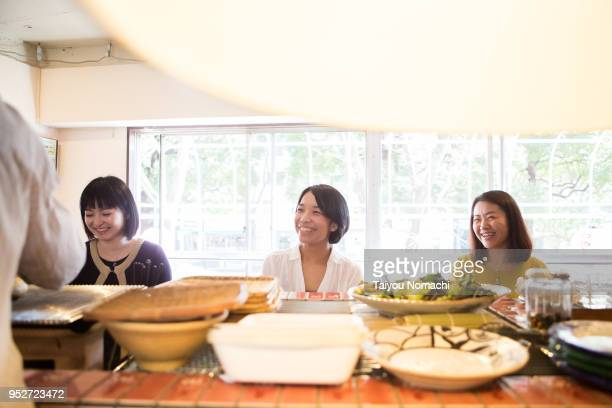 Three women enjoying dining at a restaurant