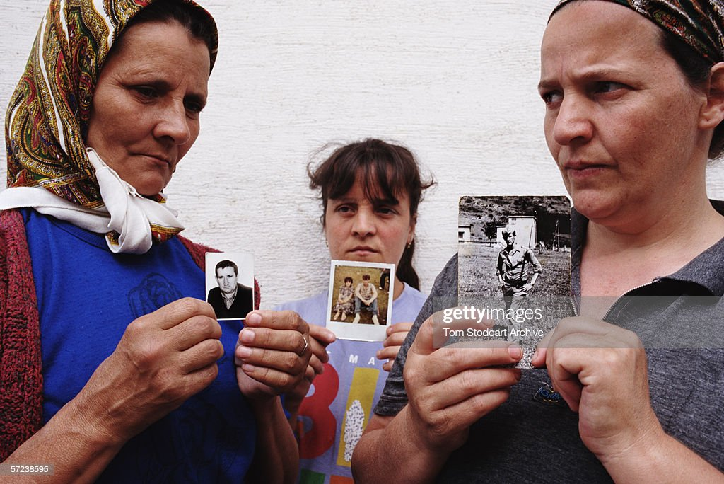 Three women from the Bosnian village of Srnice whose husbands are all dead or missing after the Srebrenica massacre. They are photographed at the refugee centre set up at the Tuzla Woman and Child Centre for survivors and refugees of the massacre.