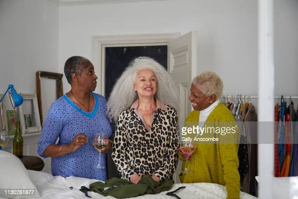 Three women getting ready in the bedroom