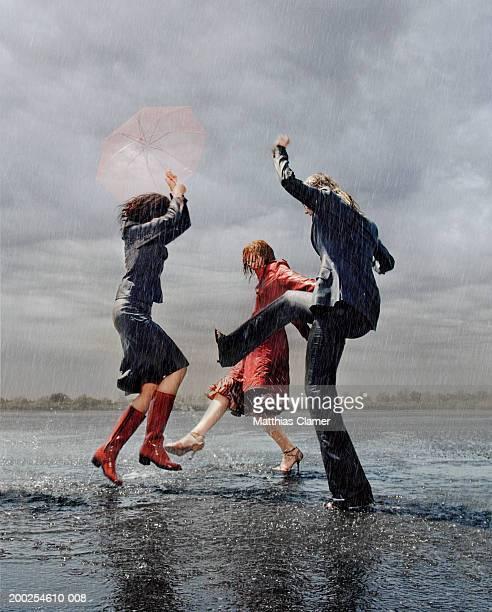 Three women having fun in rain