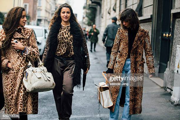 Three women in leopard print outfits Two women with leopard print outfits pass by Irina Lakicevic as she is about to be photographer in a leopard...
