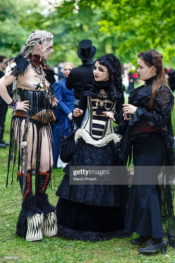 Three women in Victorian-style clothing chat during the traditional park picnic on the first day of the annual Wave-Gotik Treffen, or Wave and Goth Festival, on May 17, 2013 in Leipzig, Germany. The four-day festival, in which elaborate fashion is a must, brings together over 20,000 Wave, Goth and steam punk enthusiasts from all over the world for concerts, readings, films, a Middle Ages market and workshops.