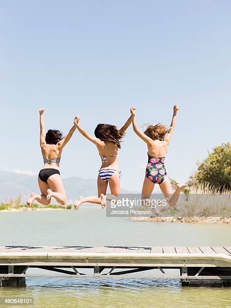 Three women jumping into lake, Salt Lake City, Utah, USA