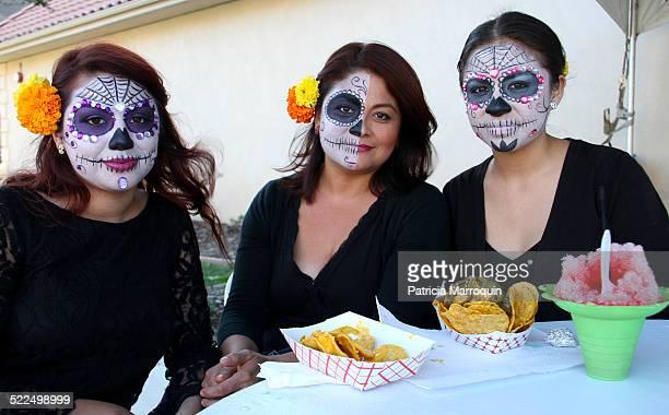 Three women made up as Catrinas at a Dia de los Muertos celebration in Camarillo Ventura County California in November 2013
