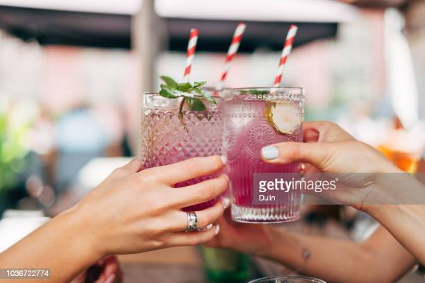 three women making a celebratory toast - cocktail stock pictures, royalty-free photos & images