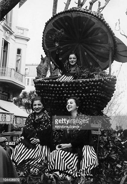 Three women on a float in the shape of an orange during the lemon and orange festival in Menton on February 28 1938