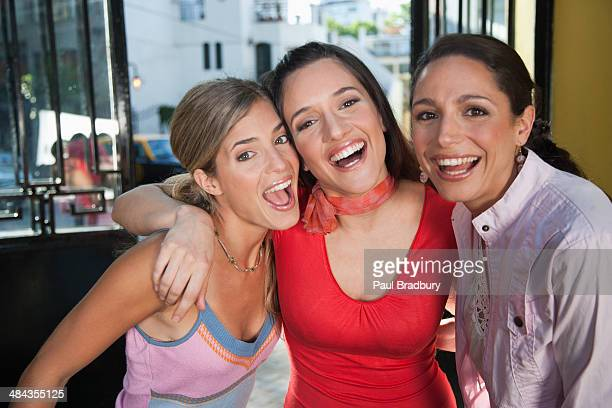 three women on outdoor smiling - birthing chair stock pictures, royalty-free photos & images