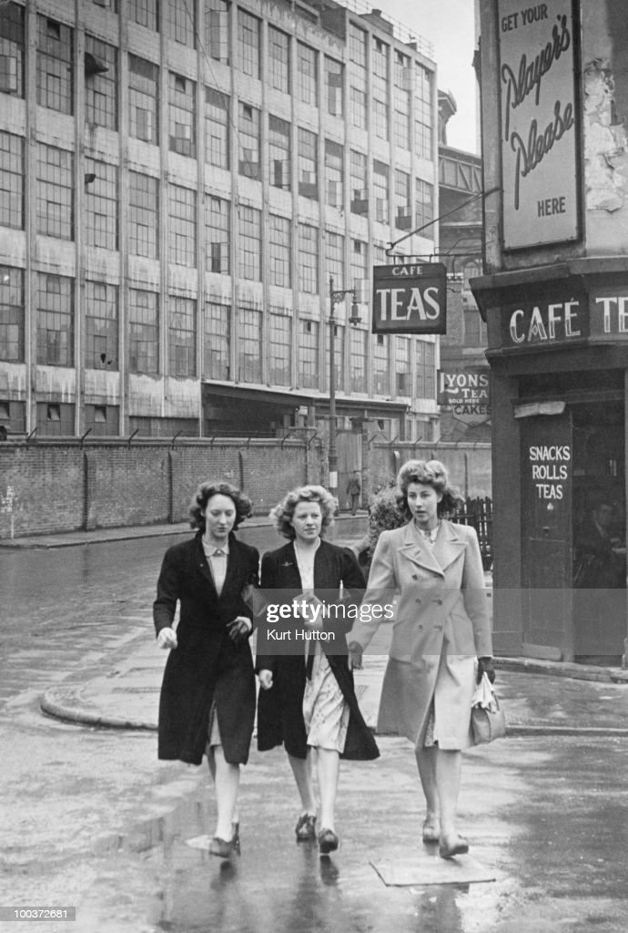 Three women on the way from the factory where they work to church, where they will pray for their servicemen husbands, Battersea, London, June 1944. Original publication: Picture Post 1731 - Three Girls Go To Church To Pray For Their Husbands - Pub. 24th June 1944