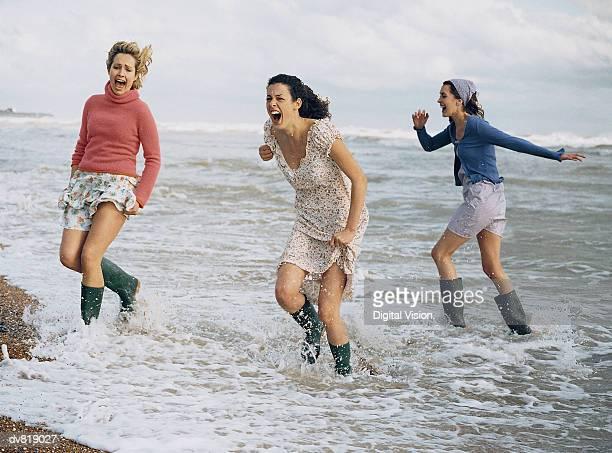 Three Women Paddling at the Seaside