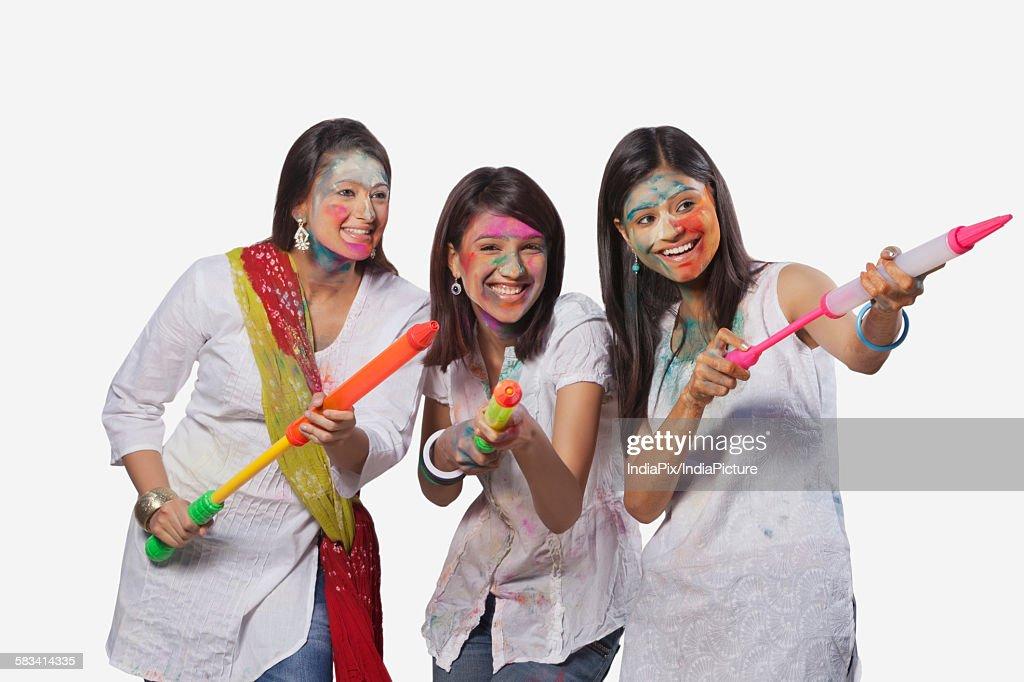 Three women playing holi : Stock Photo