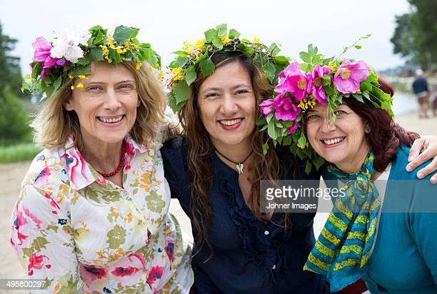 three women posing together, nykoping, sodermanland, sweden - midsommar bildbanksfoton och bilder
