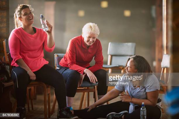 three women resting and laughing in gym. - dansstudio stock pictures, royalty-free photos & images
