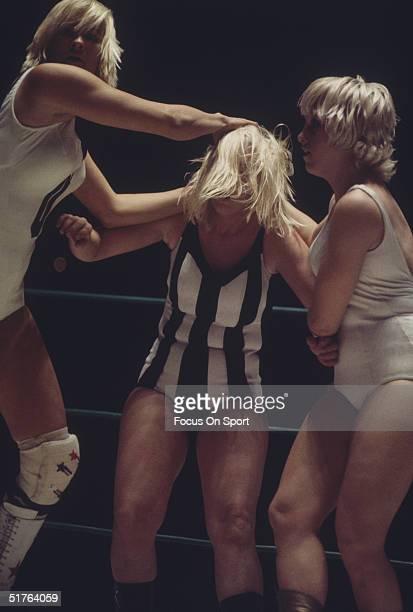 Three women tagteam wrestle circa 1970's