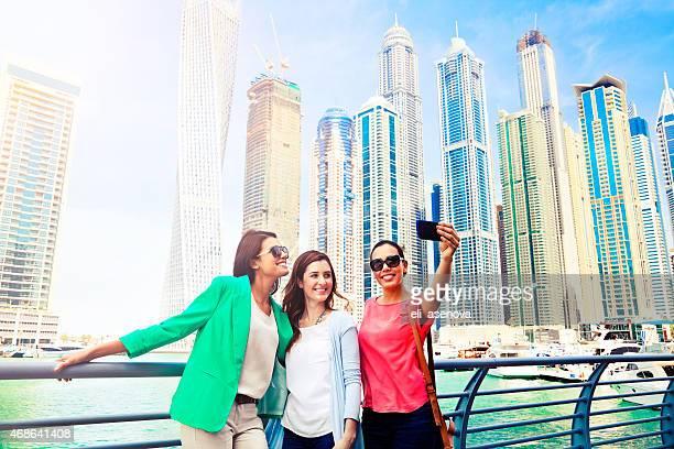 three women take selfie in dubai marina - tourist stock pictures, royalty-free photos & images