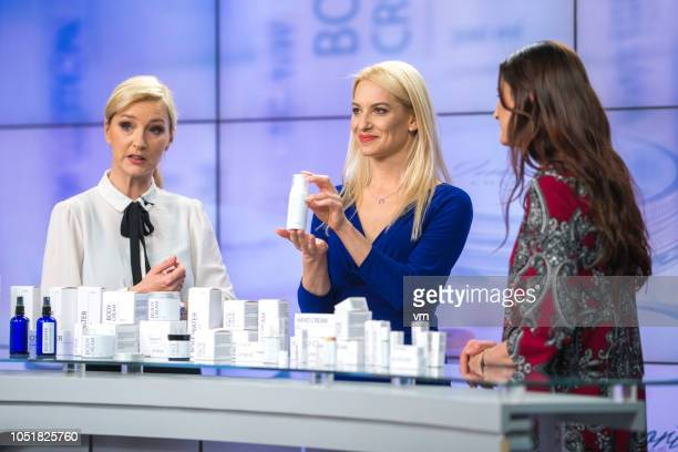 three women talking about cosmetics on a tv infomercial - television show stock pictures, royalty-free photos & images