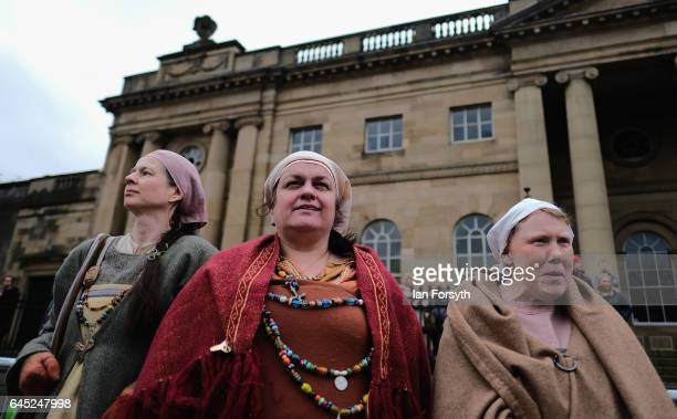 Three women Viking reenactors watch on as a battle takes place during a living history display on February 25 2017 in York United Kingdom The march...