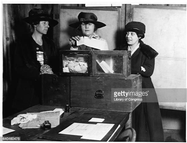 Three women vote at a polling station in New York City New York USA