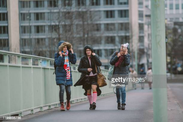 Three women walks against the strong wind upon the Storm Sabine arrival on February 9 2020 in Cologne Germany