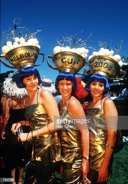 Three women wear an extravagant costume while attending the Melbourne Cup November 7 2000 at Flemington Racecourse in Melbourne Australia The...
