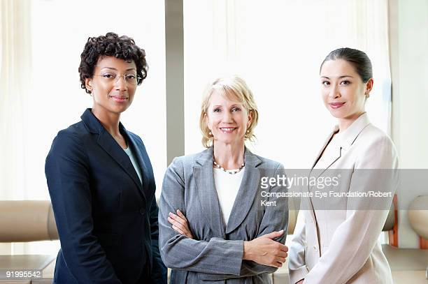 three women wearing business suits