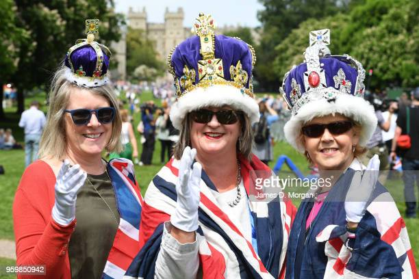 Three women wearing crowns as they wait 24 hours before the Royal procession on the Long Walk on May 18, 2018 in Windsor, England. The Berkshire...
