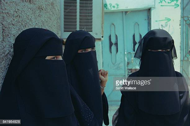 Three women wearing the niqab in Aden Yemen 2004