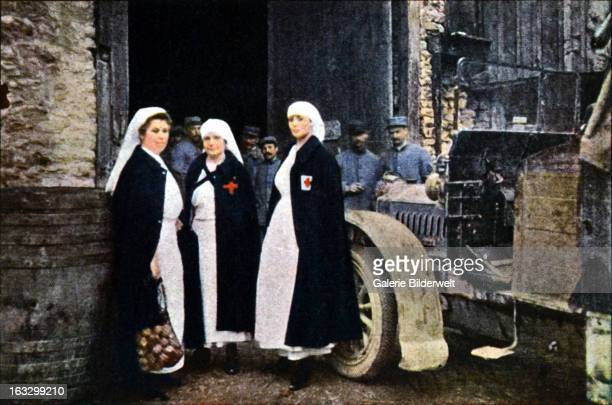 Three women wearing the Red Cross and the French ambulance staff with a vehicle September 1916 Battle of Verdun Western Front World War I France...