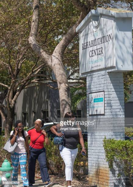 Three women who said they were employees of a rehabilitation center where six patients were found dead leave the center September 13 2017 in...