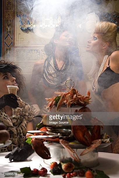 Three women with a feast of seafood