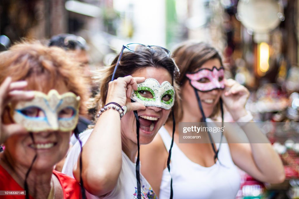 Three women with three masks on the streets of Naples, Italy : Stock Photo