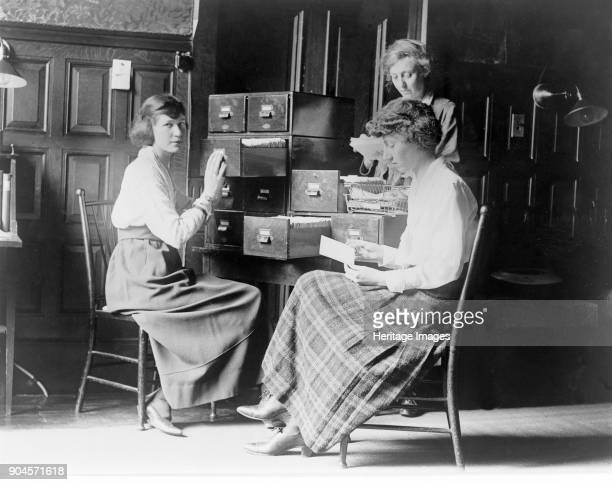 Three women work at the card index files at the headquarters of the National Woman's Party Washington DC pub c1920