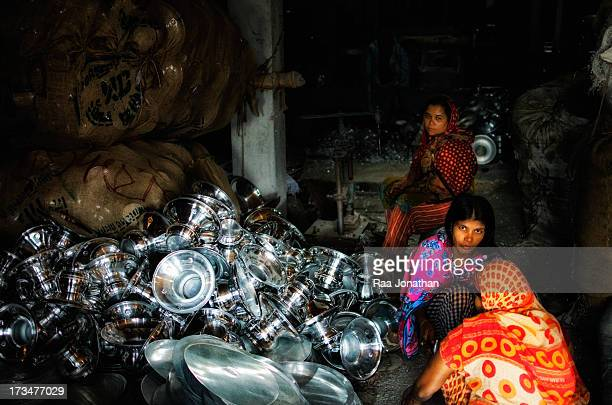 Three women's are working in a silver pot factory in Dhaka.