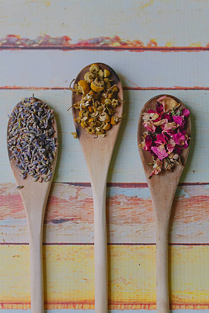 Three wooden spoons filled with dried flowers