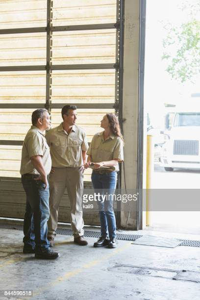 Three workers for trucking company having meeting