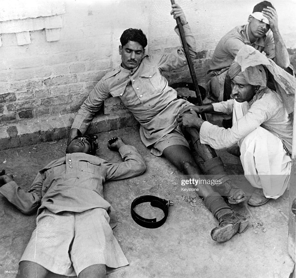 Three wounded Indian policemen receiving treatment following the riots in Lahore when Sikhs Hindus and Muslims clashed over the decision to...