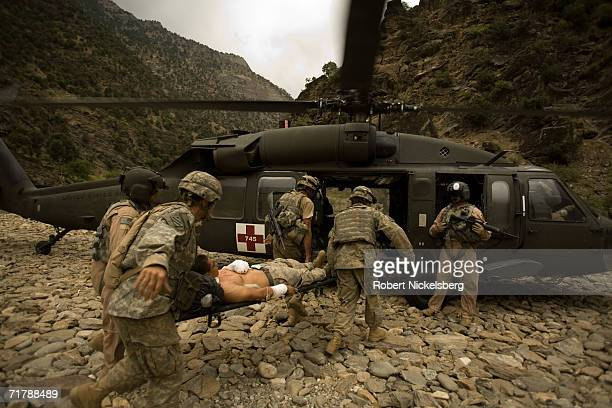 Three wounded US Army soldiers from the 10th Mountain Division are moved for evacuation to a helicopter in Kamdesh Nuristan August 27 eastern...