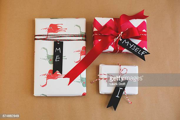 Three wrapped gifts tagged with Me Myself and I