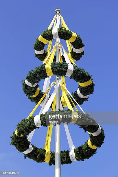 Three wreaths and blue sky in the background.