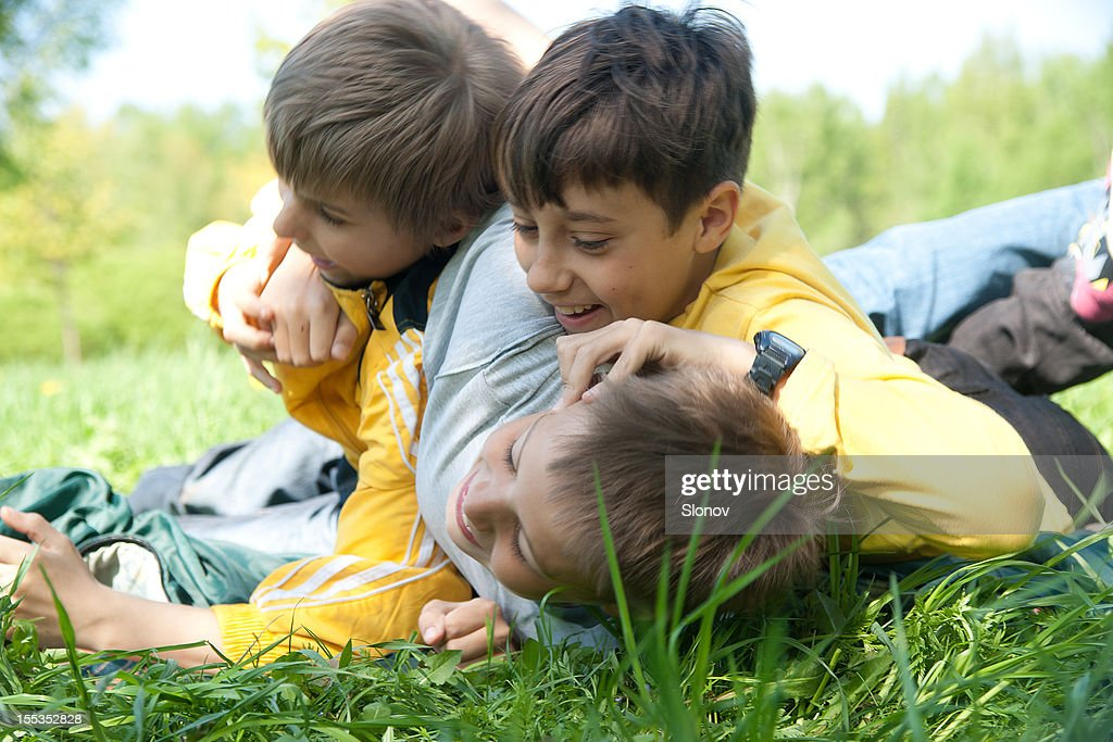 Three Wrestling Boys : Stock Photo