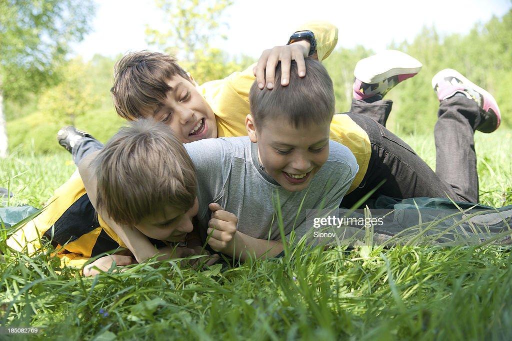 Three Wrestling Boys : Stock Photo