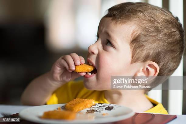 Three year old eating fish