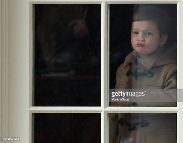 Three year old Joseph Kushner pushes his nose against a window in the Oval Office while waiting to depart with his grandfather US President Donald...