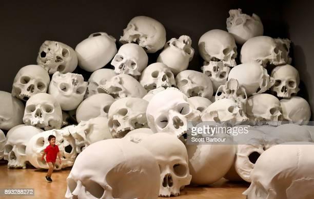Three year old Josh Bedford runs through artist Ron Mueck's worldpremiere installation 'Mass' consisting of 100 largerthanlife skulls each measuring...